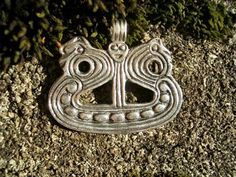 Viking ship design pendant, originally a brooch found in a woman's century grave, 8th century. Danish National Museum