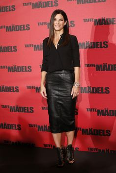 Black leather pencil skirt and a silky button-down, then finished again with edgy footwear.