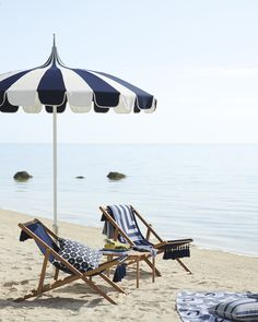 Relax beach-side in our tasseled sling chair made of weather-resistant grade A teak. Our striped beach umbrella complements the chic chairs while providing plenty of shade. Home Furniture, Outdoor Furniture, Outdoor Decor, Cheap Furniture, Beach Hacks, Beach Umbrella, Parasol, Cool Chairs, Bag Chairs