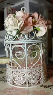 Birdcage that altered from Michaels.  A mini album is inside of the birdcage.