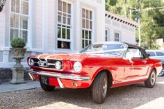 Bright red convertible Ford Mustang wedding car.