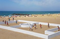 benedetto bufalino installs a walled football field on a beach in anglet, france