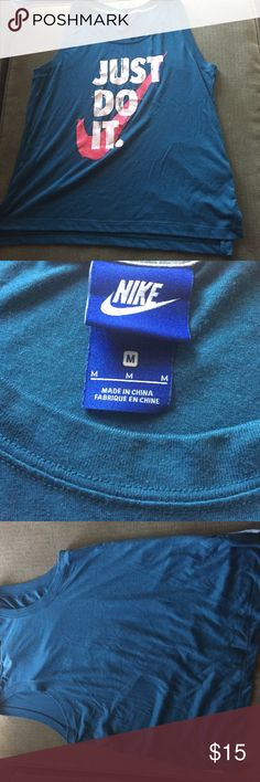 NWOT Size M Nike Tank brand new just took tags off and doesn't work for me sadly. Nike Tops Tank Tops