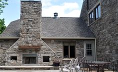 Outdoor Fireplace with Barn Beam Mantle and inserted openings. Price Quartz J&N Stone