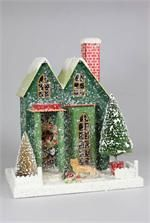 Pressed paper putz house with bottle brush trees,fox, mushrooms, and mica accents.