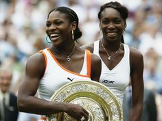 Serena Williams (left) holds the 2003 Wimbledon trophy after beating her sister Venus in the women's singles final.  Alex Livesey, Getty Images