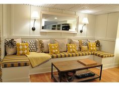 Basement seating area - but what I'm really loving is the ceiling tiles that don't look gross