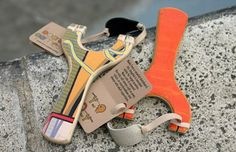 Homemade slingshots in the Board Games Etsy shop -- made from upcycled skateboards!