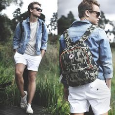 Classic denim jacket, white shorts, stripe tee and a backpack.