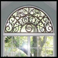 Beautiful Fish Design Within Faux Iron Arched Window Treatment