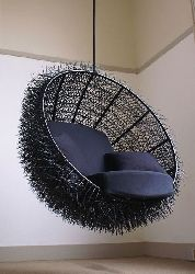 This lounge chair is the perfect spot to spend your lazy sunday afternoon reading a book. The inside of the chair is padded with soft cushions while the outside is covered with a structure of 8000 cable-ties. Every cable-tie is painstakingly stripped to another to give it the spiky appearance of the sea creature it's named after.    Description: Lounge Chair, stainless steel frame, cable-tie cover  Dimensions: 80 x Ø 130 cm / 31,5 x Ø 51,2 inch  Design: OOOMS