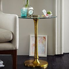 "Molded Brass Side Table. $239. 20"" diameter 22""h. between Eames lounge chairs."
