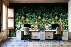 Designer: Catalina Estrada, Barcelona, Spain A modern workspace with a feature wall by artist Catalina Estrada. A great balance of colors and patterns are seen in this room, with a stunning forest wall mural making a bold statement.