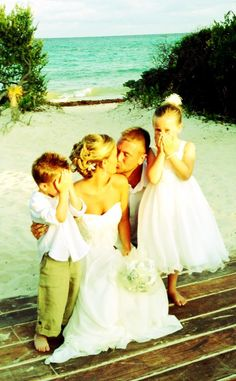 My kids - Ring Bearer & Flower Girl in their cousin's Beach Wedding in Playa Del Carmen Mexico @ the Paradisus La Perla Resort.  Love this picture - ring bearer covering his eyes, and flower girl suppressing a giggle while the Bride & Groom kiss!