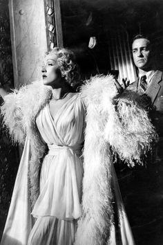 LOOK TO THE STARS Monsieur Dior had an undying love for the cinema; his friendship with Marlene Dietrich yielded legendary film costumes, such as those seen in Stage Fright (pictured). Today, several of Hollywood's most recognizable faces represent the fashion house, including Jennifer Lawrence, Marion Cotillard and Natalie Portman.   - HarpersBAZAAR.com