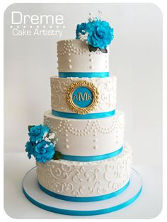 turquoise and white wedding cake.. Not my favorite colors, but I like the style.