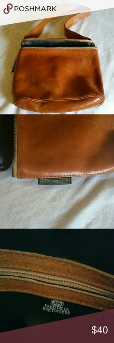 Fred de la Bretoniere leather handbag. Caramel color, small bag with wide strap. Very cute, but does have some scratches due to wear (see picture). I got this from my mom, but my purses are overflowing. Fred de la Bretoniere Bags Shoulder Bags
