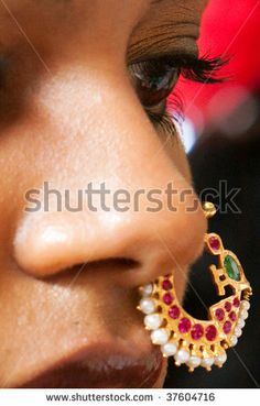 A closeup of the face and nose ring of a young Indian brde - stock photo