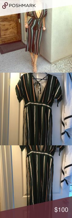 Faithfull Pant Jumpsuit Faithfull Pant Jumpsuit from Madison Clothing Store . Low V neck front and low back as well. Needs to be ironed. No longer sold in store. Worn twice 💞 Faithfull the Brand Dresses