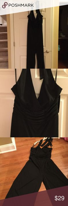 Sexy halter jumpsuit NWT halter jumpsuit with defined waistband and back zip (to mid back). Full length wide legs. Jumpsuit has a sheer top layer-see last photo. This can be dressed up for a night on the town or a wedding... Pants Jumpsuits & Rompers