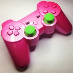 A custom modded Candy Pink PS3 rapid fire controller.
