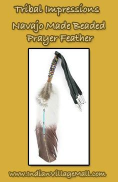 "Navajo Made Beaded Prayer Feather Navajo crafted prayer feather with bead work and leather tassels. Feather has a painted design down the center. Feather measures about 10"" long and 2"" wide. Beaded area is about 2"". With the leather tassels, this feather can also be used as a hair feather tie. Pattern and color may vary. Crafted by Lance Richards. Review The Tribal Impressions Collection off of: http://www.indianvillagemall.com/feathers.html"