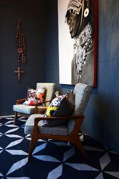 African+inspired+room+with+large+wall+art | residential interior | blue walls | wooden chairs | modern colorful home decor