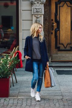 Katarzyna Tusk pairs simple ripped jeans with a casual striped top and navy overcoat. Top: Mango, Jeans: Zara, Coat: Stefanel.