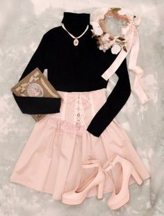 Black tight-fitting top with high waisted pink skirt.