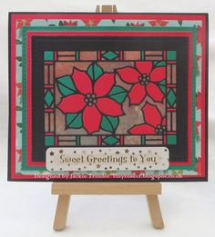 Tinyrose's Craft Room: Stained Glass PoinsettiaGood evening. I made this  Christmas card with Stained Glass Poinsettia die from Creative Expressions. There are more details on my blog.