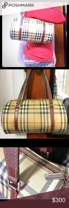 Vintage Burberry barrel bag In good condition, this is a vintage classic Hay market  check barrel bag. Great style that can be matched in ang get up. Inside has single accessory pocket. Gently used. Some slight wear on canvas and inside lining but does not affect overall appearance. Please check pictures. Brown leather trimmings. Burberry Bags Shoulder Bags