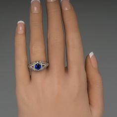 This stunning rich blue sapphire engagement ring features a diamond encrusted platinum filigree mounting set with a 1.09 carat sapphire. The diamonds are all high quality and the detail work and engravings on the mounting are truly spectacular. We can size this beauty to fit.