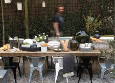 Love the styling for outdoor dining here - mix and match Tolix armchairs look great