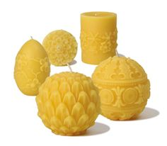 sculpted and molded pillars are handmade with unscented, naturally filtered beeswax
