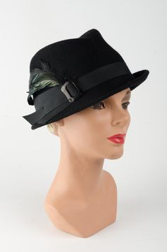 ac0e4c06660 This cute little trilby hat goes by the name Jean. With its simple asymmetric  brim