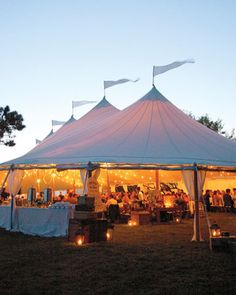Love this Wedding reception tent with the lanterns