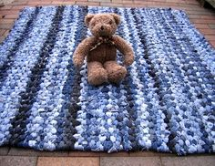 Recycled blue jeans made into braided kids rug and some other ideas for rugs made out of old blue jeans.