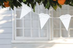 We absolutely LOVE this paper doily bunting! It is SO easy and beautiful! It's also very inexpensive to make and requires very little skill to make it perfectly. We found these doily's at our local supermarket. You could also use fabric or lace doilies if you wanted to play around with the color and texture. …
