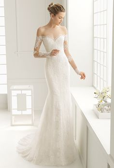 Brides: Rosa Clará. Off-the-shoulder mermaid dress in Chantilly and corded lace. Long illusion sleeves and a deep-V back.