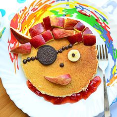 Some dishes become more special when we serve them in an innovative way. That's what we have done with these pancakes. Inspired by the pirate theme, we have used some simple ingredients to decorate this pancake like the face of a dreaded pirate! We are sure that your kid will love it for breakfast. What say Momma?