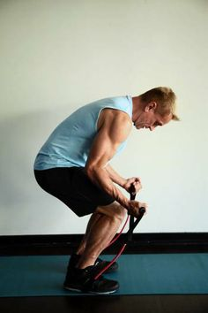 "The ""Crouch to Superman"" exercise uses tubing and works your legs, back and shoulders. #exercise"