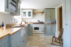 I don't know about the blue cabinets, but like the layout and muted colors Farmhouse kitchen. I don't know about the blue cabinets, but like the layout and muted colors Farm Kitchen Ideas, New Kitchen, Kitchen Stove, Duck Egg Kitchen, Kitchen Grey, Kitchen Wood, Duck Egg Blue And Cream Kitchen, Kitchen Colors, Duck Egg Blue Kitchen Cabinets