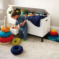 The streamlined design of The Land of Nod's Hi-Fi Toy Box will fine-tune any décor. Its spacious interior and additional drawers give it plenty of storage space, while its powder coated iron base makes it ultra durable. Plus it's available in two different finishes to complement your style.