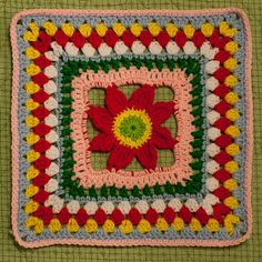 """I'm making this square for my """"Be of Good Cheer"""" Samplerghan. :o)  A fun square to crochet. Mine doesn't look much like a sunflower, though, because of the colors I used. (The example in the ..."""