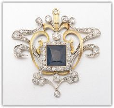 GOLD, DIAMOND AND BLUE SPINEL PENDANT.