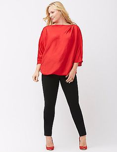 Sleek satin tunic makes for a memorable entrance with its graceful drape and asymmetric silhouette. Boat neckline with a pleated shoulder detail, drama sleeves and an elastic hem create a truly unique silhouette that's dressy enough for any occasion. lanebryant.com