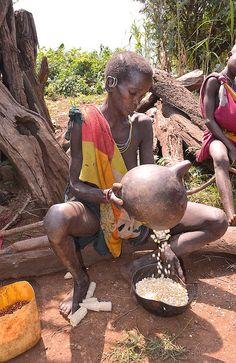 Winnowing Corn, Suri Tribe, Kibish,Ethiopia