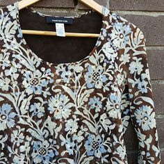 Flower and Sequin Top Pretty earth toned top with brown, blue, and beige floral pattern. Clear sequins on front give this top some shimmer. 100% polyester. Front and back are fully lined. Excellent condition with no tears, stains, or pilling. No trades, holds, or Paypal. Jones New York Tops
