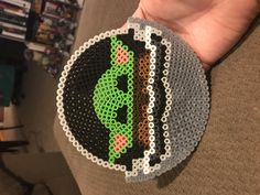 My version of Baby Yoda - circular design based off of Sheetskees design posted . - My version of Baby Yoda – circular design based off of Sheetskees design posted here. Easy Perler Bead Patterns, Melty Bead Patterns, Perler Bead Templates, Diy Perler Beads, Perler Bead Art, Pearler Beads, Fuse Beads, Beading Patterns, Disney Hama Beads Pattern