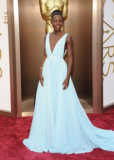 Lupita Nyong'o in Prada, 2014I'm not the kind who subscribes to the notion of Disney princess red carpet moments, but there was something truly magical about the Prada dress that Lupita Nyong'o wore to the Oscars in 2014. First off, the pale sky blue color was such a great match for the actress, and a shade you don't see too often in Hollywood. The silhouette was pretty special, too; seeing Nyong'o climb the steps to receive her award with a trail of pleated silk chiffon behind her was…